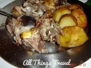 Roast lamb and pork and potatoes