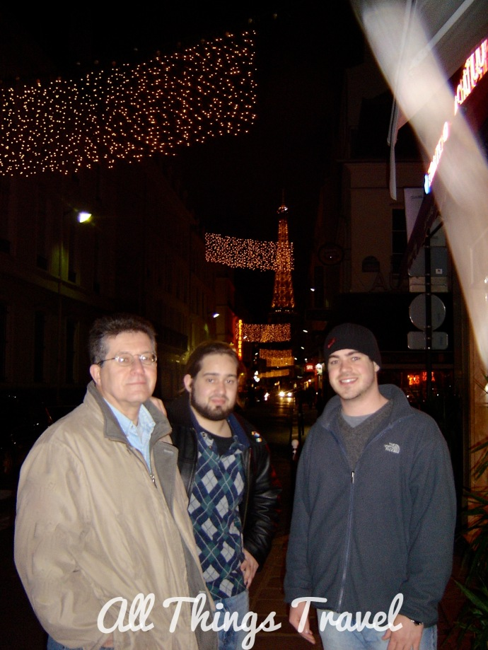 My husband and sons with Eiffel Tower and Christmas Lights in Paris